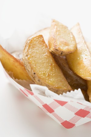 potato wedges: Potato wedges in cardboard container