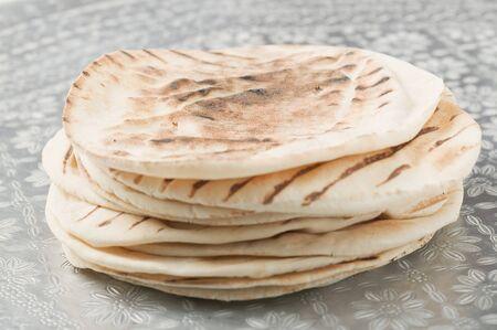 several breads: A stack of grilled flatbread LANG_EVOIMAGES