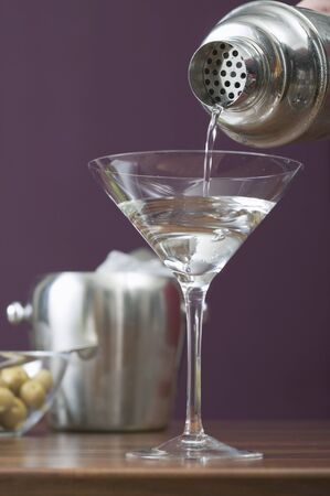 martini shaker: Pouring Martini out of cocktail shaker into glass