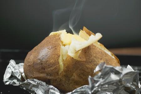 jacket potato: Steaming baked potato