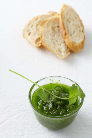 mojo: Green mojo sauce in glass basin, slices of white bread LANG_EVOIMAGES
