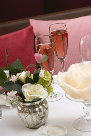 champers: Two glasses of pink champagne on romantic table LANG_EVOIMAGES