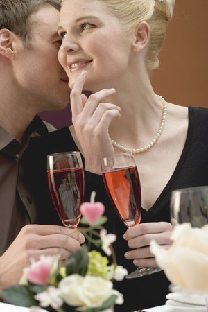 25 to 30 year olds: Romantic couple with glasses of sparkling wine