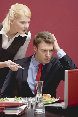 25 to 30 year olds: Office colleagues with computer probems working through lunch