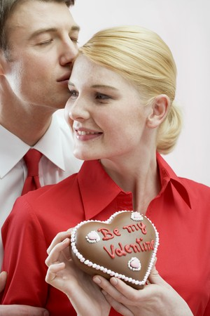 30 to 35 year olds: Couple with chocolate heart on Valentines Day