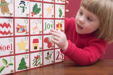 Small girl with Advent calendar