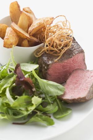 potato wedges: Beef fillet with deep-fried onions, salad & potato wedges