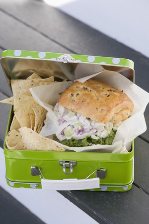 lunch box: Chicken sandwich and crisps in lunch box