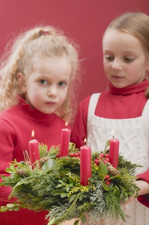 ignited: Two small girls holding Advent wreath
