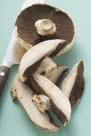 giant mushroom: Portobello mushrooms, one sliced