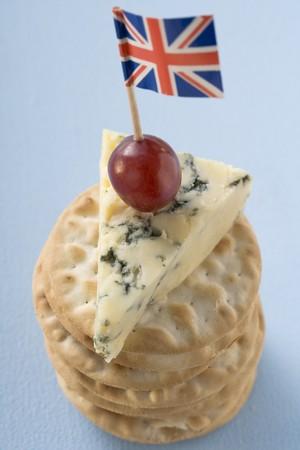 stilton: Piece of Stilton with grape and Union Jack on crackers