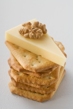 emmental: Piece of Emmental cheese with walnut on crackers