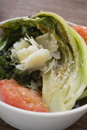 romaine: Braised romaine lettuce with tomatoes and Parmesan