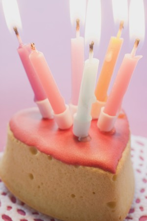 ignited: Small birthday cake with burning candles