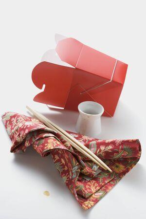Empty take-away container, chopsticks, napkin