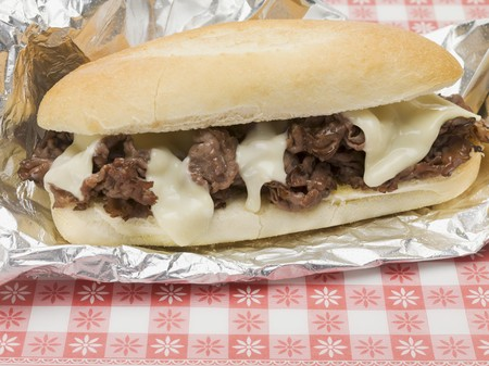 strips away: Shredded beef sandwich with melted cheese on aluminium foil LANG_EVOIMAGES