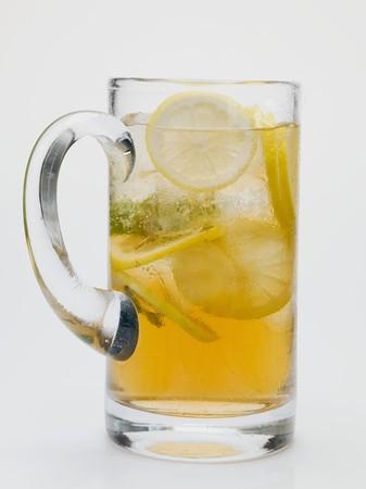 lemon slices: Iced tea with lemon slices in glass jug