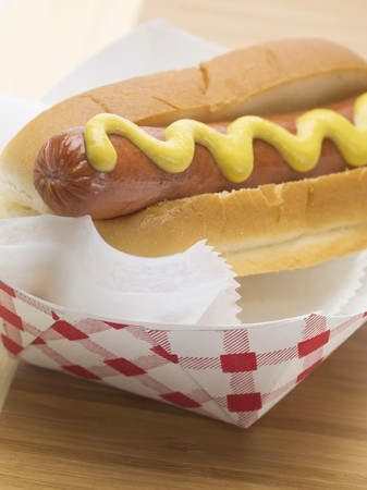 scalded sausage: Hot dog with mustard in paper dish
