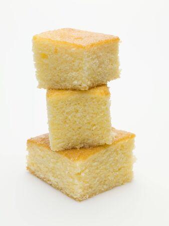 cornbread: Three cubes of cornbread, stacked
