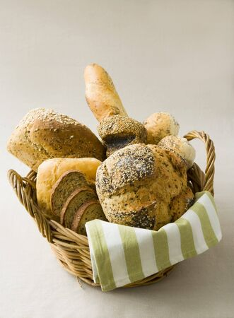 several breads: Assorted breads and bread rolls in bread basket LANG_EVOIMAGES