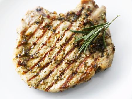 pork chop: Grilled pork chop with rosemary LANG_EVOIMAGES