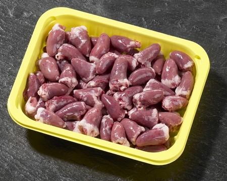 innards: Chicken hearts in plastic container