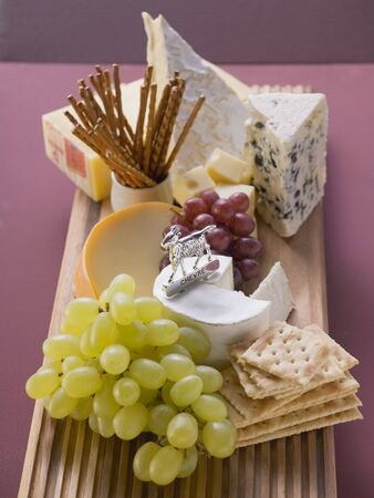 nibbles: Cheese board with grapes and nibbles