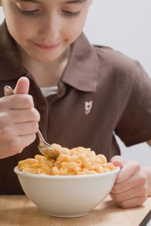 5 10 year old girl: Little girl eating macaroni cheese
