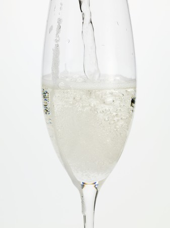 champers: Pouring sparkling wine into a glass
