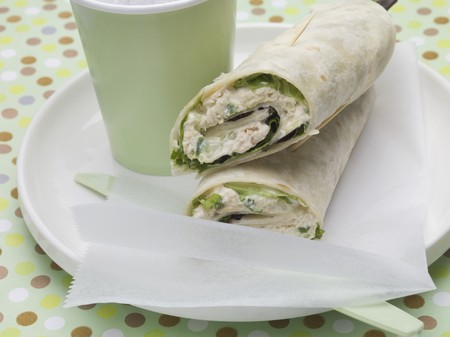tunafish: Wraps and drink on plate