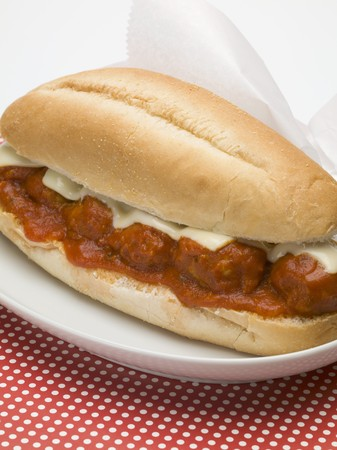 hero sandwich: Meatball sub sandwich with tomato sauce and cheese