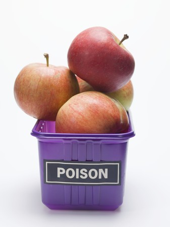 pip: Red apples in a plastic punnet with a POISON label LANG_EVOIMAGES