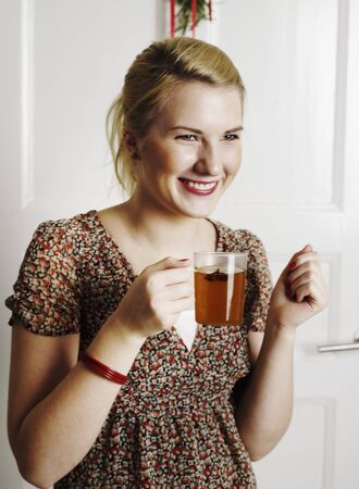 30 to 35 year olds: Young woman with a glass of punch LANG_EVOIMAGES