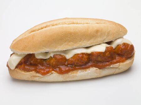 Meatball sub sandwich with tomato sauce and cheese