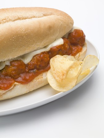 hero sandwich: Meatball sub sandwich with tomato sauce and cheese, crisps LANG_EVOIMAGES