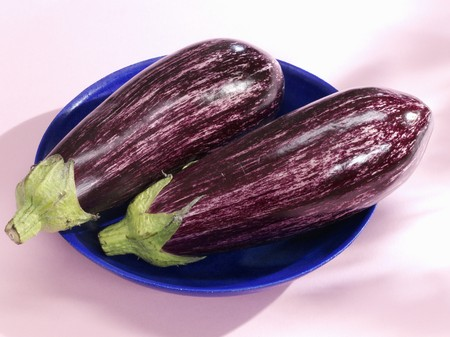 in twos: Two aubergines
