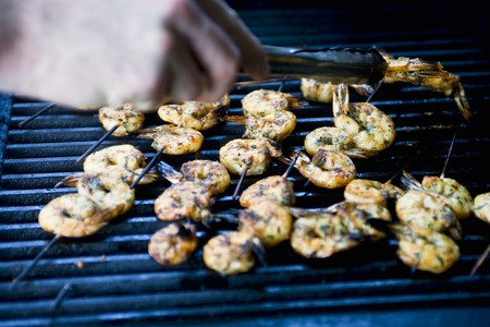 qs: Prawn skewers on a barbecue