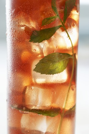 iced tea: A glass of iced tea with mint