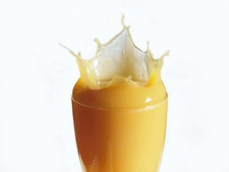 squirted: Mango nectar splashing out of a glass