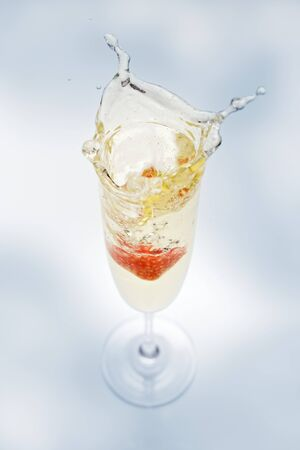 champers: A glass of sparkling wine with strawberry (splash)