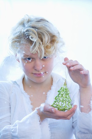 16 to 17 year olds: Girl with Christmas tree ornament LANG_EVOIMAGES