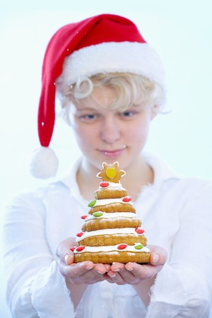 16 year old girls: Girl holding biscuit Christmas tree