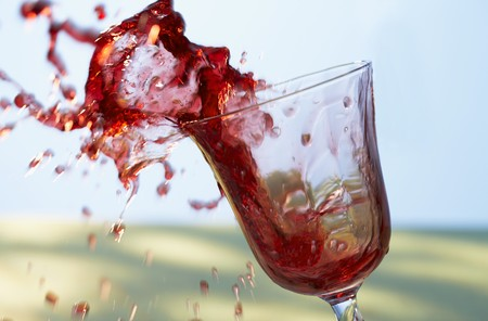 squirted: Red wine splashing out of a glass