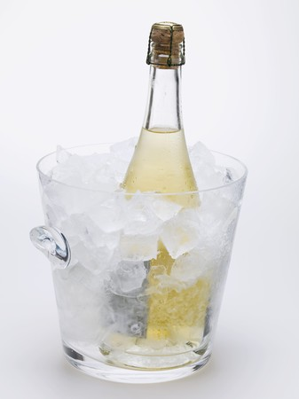 chilled out: Bottle of sparkling wine in ice bucket
