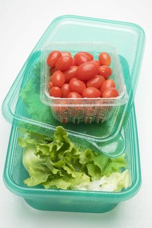 tupperware: Lettuce in food storage box, tomatoes in plastic punnet