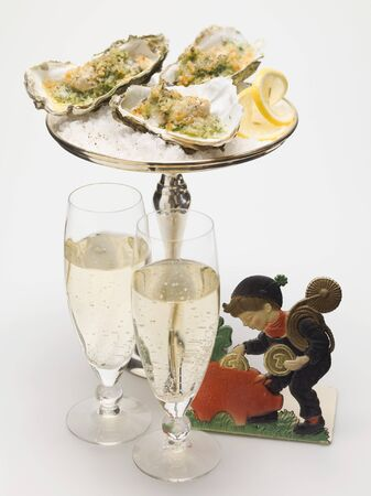 lucky charm: Oysters au gratin, glasses of sparkling wine & lucky charm