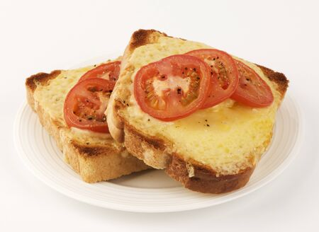 qs: Two slices of cheese and tomato on toast