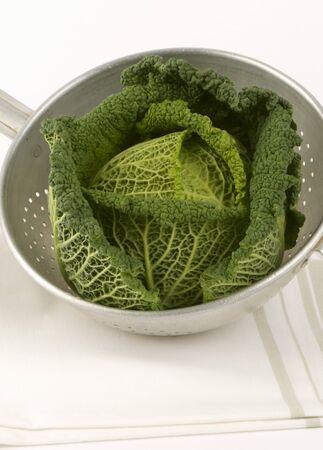 savoy cabbage: A savoy cabbage in a colander