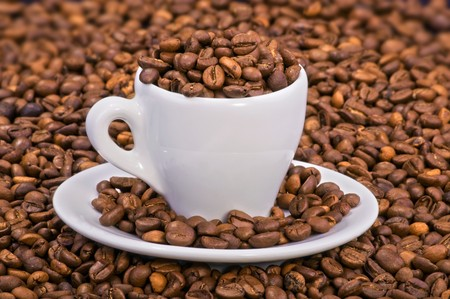 brownness: Coffee beans in espresso cup and saucer LANG_EVOIMAGES
