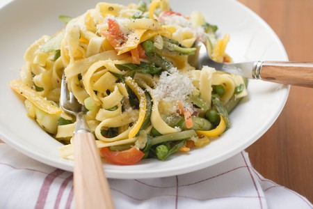 primavera: Tagliatelle primavera with vegetables & grated cheese on plate LANG_EVOIMAGES